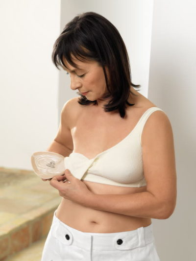 Women with mastectomy bra and breast form